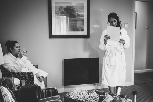 Wedding Photographer Solihull, the bridesmaid opening a bottle of champagne during the preparations at The Westmead Hotel Birmingham, reading her speech