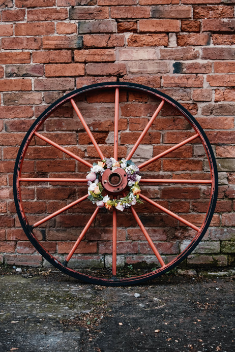 Wedding Photography Solihull, the brides hair flower garland on a wheel @wootton park Warwickshire