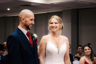Wedding Photographer Birmingham, bride & groom smiling during the wedding ceremony at the Westmead hotel Birmingham
