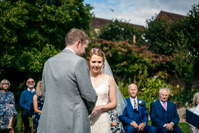 Lord Leycester Warwick wedding, bride & groom exchanging vows, outdoor wedding, solihull weding photography