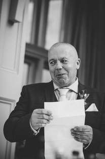 Hampton Manor Wedding Photographer Birmingham, fun relaxed wedding photograph of the father of the bride during the speeches