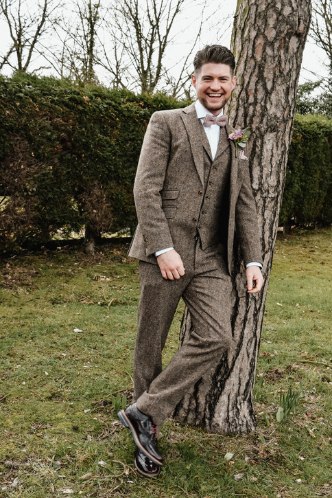 Wedding Photographer Solihull, a full length image of the groom at Wootton Park Warwickshire