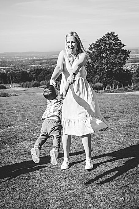 Photographer Solihull, fun photograph of mum swinging around her son, family photo session
