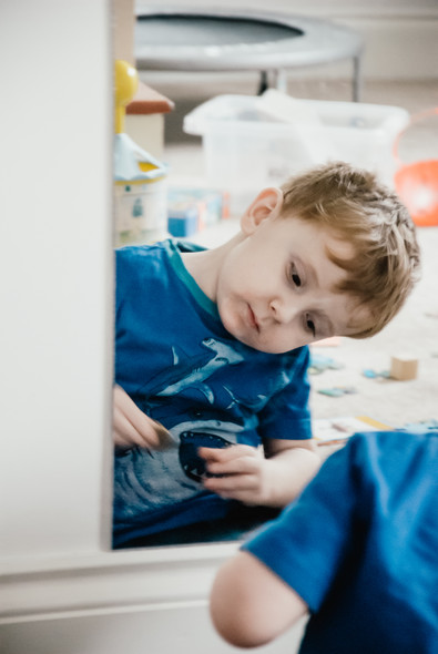 Photo story photographer Solihull, photographing a lttile boy with autism in the comfort of his own home playing