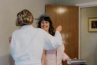 Wedding Photographer Birmingham, mother of the bride embracing the bride during the preperations, informal fun photographer at the Westmead hotel Birmingham