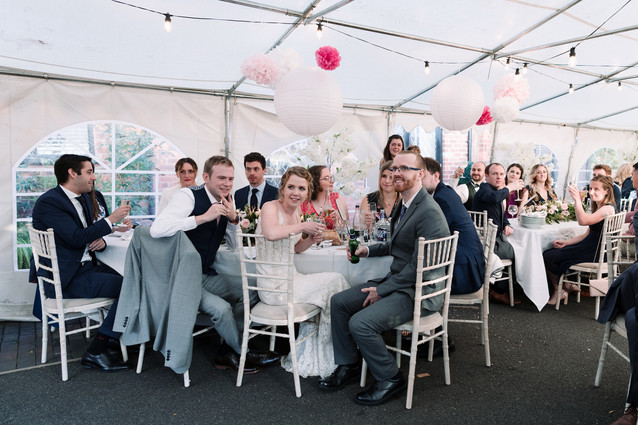 solihull wedding photography, wedding guests laughing during the speeches at the elephant & castle rowington