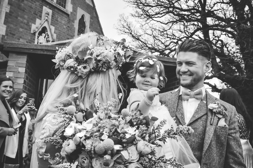 Solihull wedding photographer, bride, groom & their baby daughter just after they got married