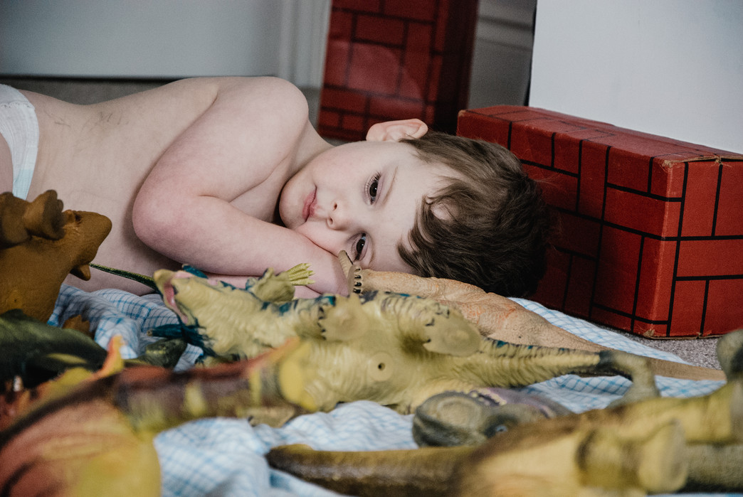 Family Lifestyle Photographer, little boy with autism playing for a photo series on kids with autism Birmingham