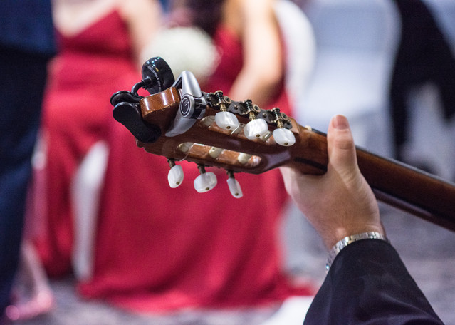 Wedding Photographer Solihull, close up image of a guitarists hand playing during the ceremony at a wedding at the Westmead Birmingham