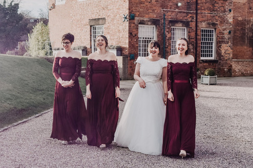 Wedding Photographer Solihull, the bride & bridesmaids walking towards the camera, fun relaxed image at the west mill derby