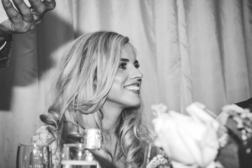 Birmingham wedding photographer, the bride laughing during the speeches at wootton park Warwickshire