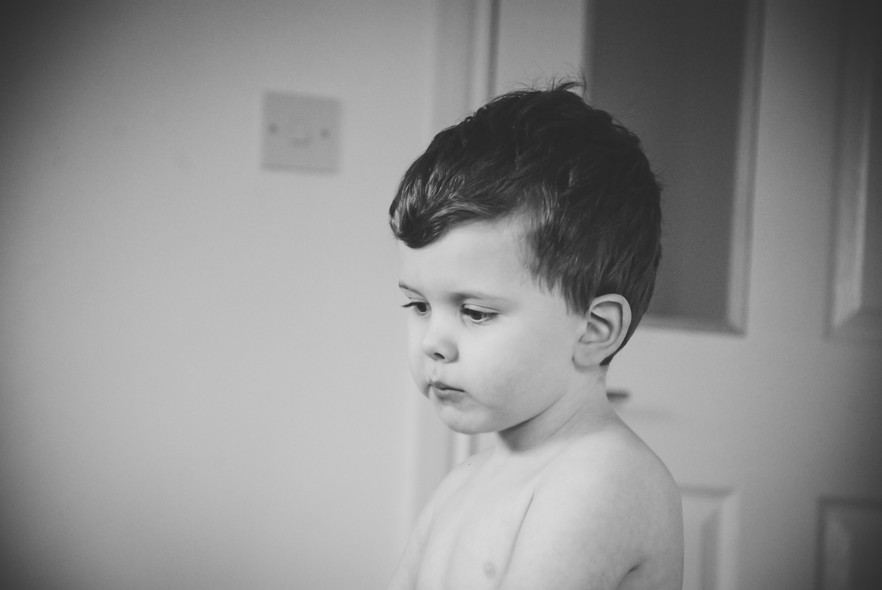 Photographing children with autism, little boy looking down, moody, relaxing kids photographer Solihull
