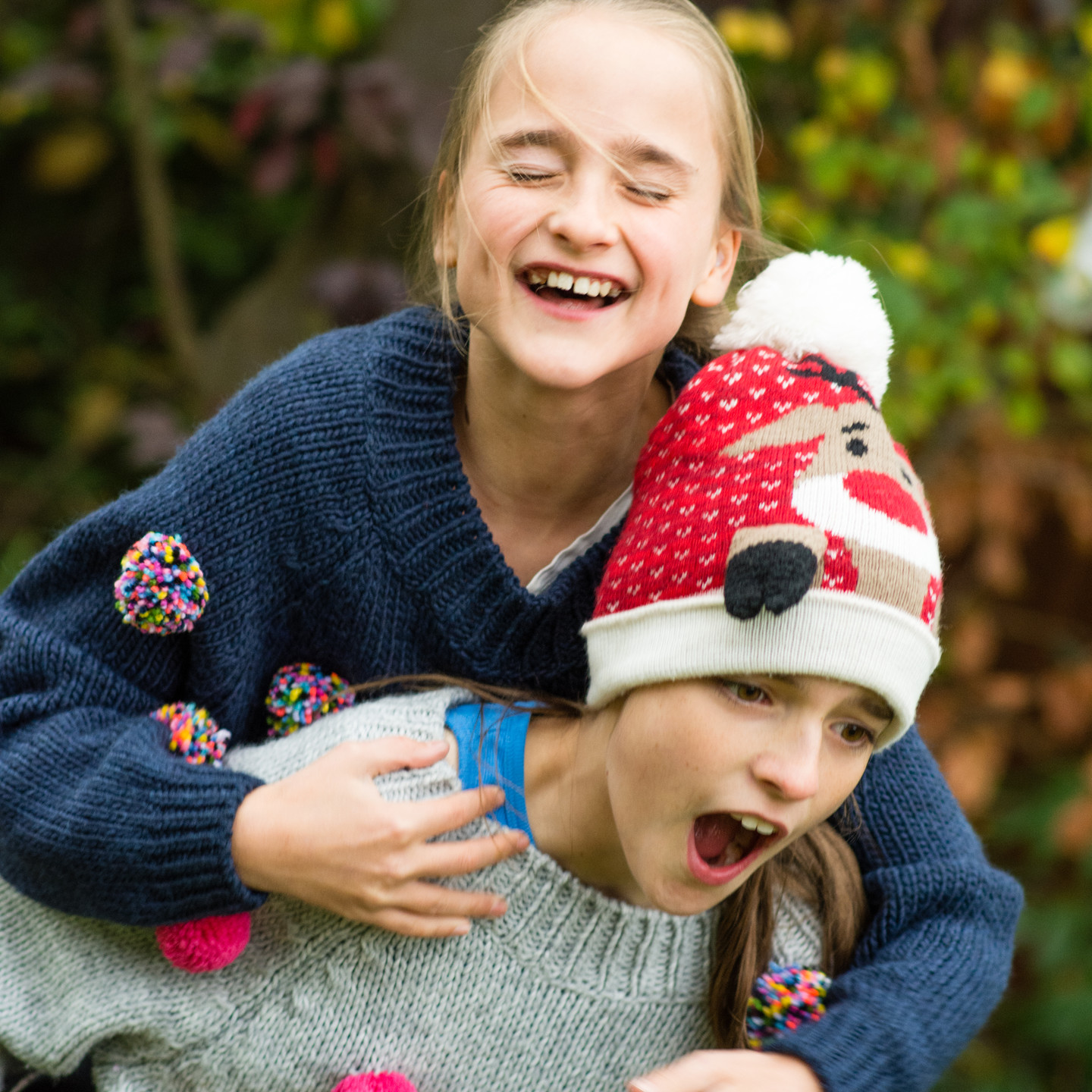 Natural kids photographs, fun photograph of girl playing giving each other a piggyback