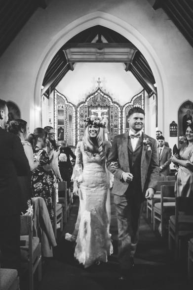Wedding Photographer Birmingham, bride & groom walking down the aisle as newly weds