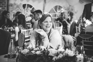 solihull wedding photography, close up image of a wedding guest laughing during the speeches