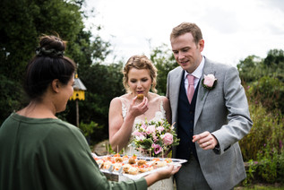 Photography wedding Birmingham, bride & groom eating canapés at the wedding breakfast at the elephant & castle Warwickshire