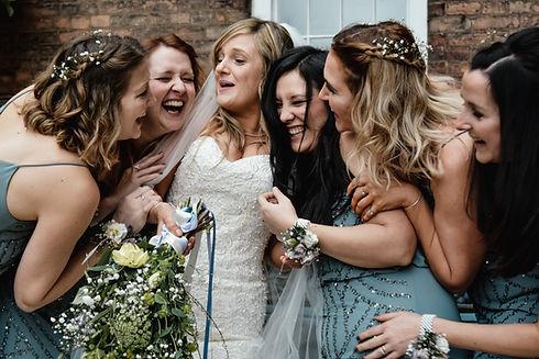 Wedding Photographer Birmingham, bride & bridesmaids having a laugh at the west mill Derby