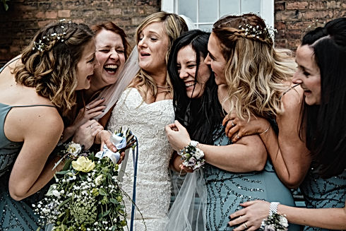 Wedding Photographer Birmingham, bride & bridesmaids having a laugh at the west mill Derby