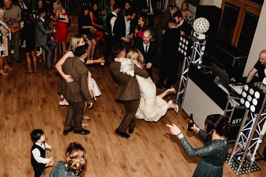 Wedding Photographer Birmingham, the bride & groom dancing to their first dance fun photograph groom lifting bride in the air, at Wootton Park Henley in Arden