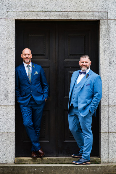 Civil Wedding Wedding Photographer Birmingham, the grooms standing in a relaxed pose outside a building in the city