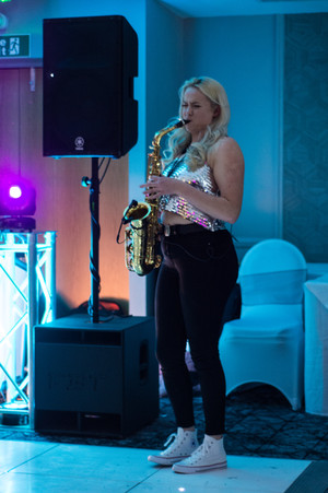 WEdding Photographer Solihull, a saxaphonist at a wedding reception Westmead hotel, Birmingham