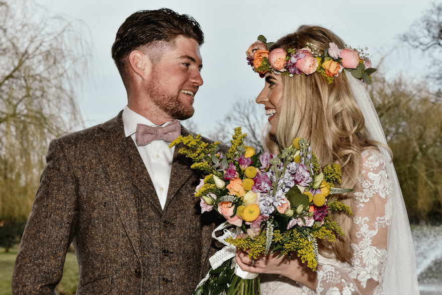 Wedding Photographer Birmingham, boho bride & her groom looking at each other, couples portraits on their wedding day @woottonpark Warwickshire