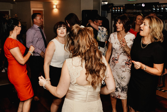 The Limes Wedding Photographer Solihull, Wedding Photographer Birmingham, fun photograph of the bride dancing with her guests