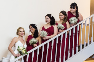 Birmingham wedding photographer, bride & bridesmaids formal photograph on the stairs at the Westmead Redditch