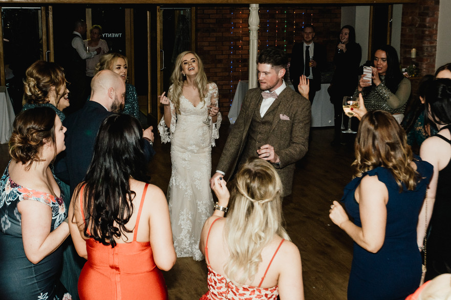 Wedding Photographer Solihull, bride & groom dancing with their guests at their wedding at Wootton Park Warwickshire