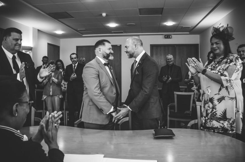 Birmingham Register Office Wedding Photographer Birmingham, the grooms holding hands during the ceremony