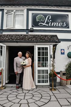 The Limes Solihull Wedding Photographer, Wedding Photographer Birmingham, the bride standing with her dad outside the wedding venue, happy relaxed full length image