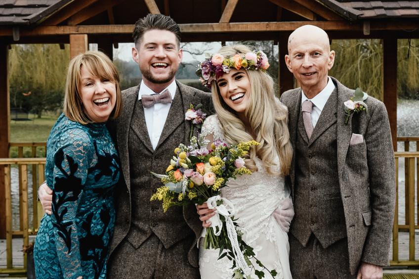 Wedding Photographer Birmingham, bride & groom with their parents fun wedding family photograph at Wootton Park Warwickshire
