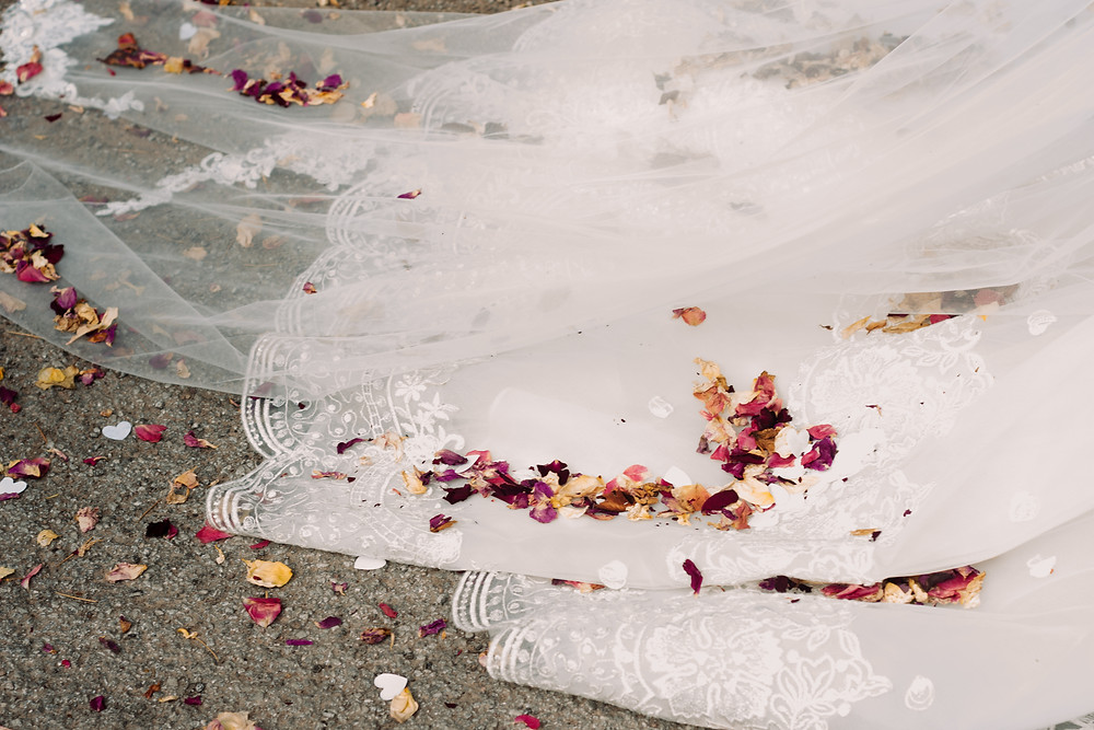 Wedding Photographer Solihull, Birmingham, the bottom of a wedding dress covered in confetti
