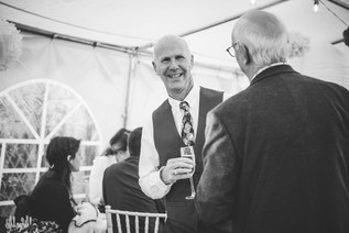 Wedding Photography Birmingham UK, the father of the bride chatting to guests at his daughters wedding, fun informal photograph at the elephant & castle Warwickshire