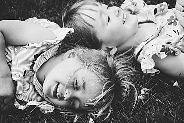 Family Photographer Birmingham, natural photograph of sisters laughing, balck & white outdoors kids photograph