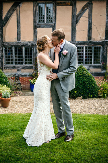 Photography wedding Birmingham, fun image of the bride and groom after the outdoor ceremony at the lord leycester Warwick wedding venue