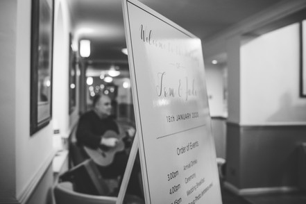 Wedding Photographer Birmingham, welcome to our wedding sign with the guitarist in the background out of focus, arty shot at the Westmead Birmingham