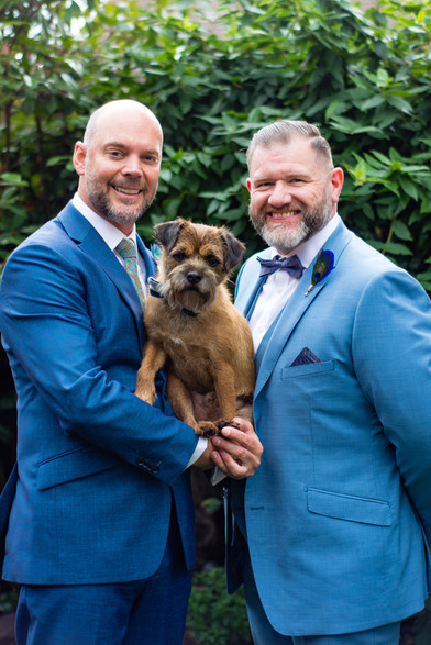 Same sex marriage photographer, the grooms posing with their dog before the ceremony