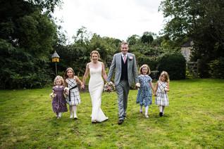 Photography wedding Birmingham, bride & groom walking with the flower girls at the elephant & castle rowington