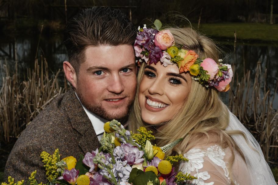 Wedding Photographer Birmingham, boho bride & groom, close up prtrait with the wedding flowers at Wootton Park Warwickshire