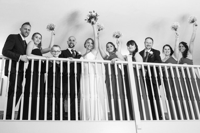 Birmingham wedding photographer, informal fun wedding groups, winter wedding at the Westmead hotel Redditch the bridal party on the staircase