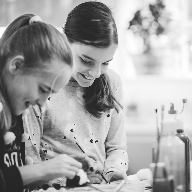 Family Photographer Birmingham, girls doing crafts family lifestyle shoot, black & white photograph