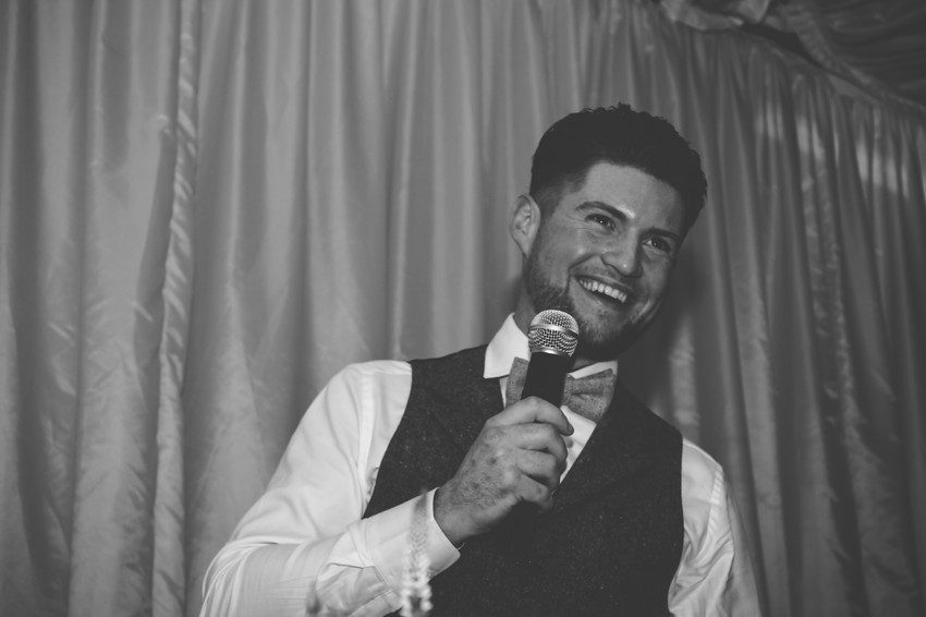 Birmingham Wedding Photographer, the groom making his speech during his wedding, laughing natural photograph at wootton Park, warwickshire