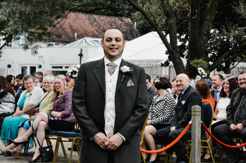 The Limes Solihull Wedding Photographer, Wedding Photographer Birmingham, the groom with his guests behind him, natural, relaxed image