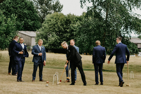 Wedding Photographer Birmingham, the groom & groomsmen playing croquet at Pendrell Hall Wolverhampton
