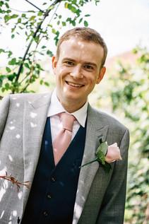 Photography Wedding Birmingham, the groom in the gardens at the lord leycester hospital Warwick wedding venue