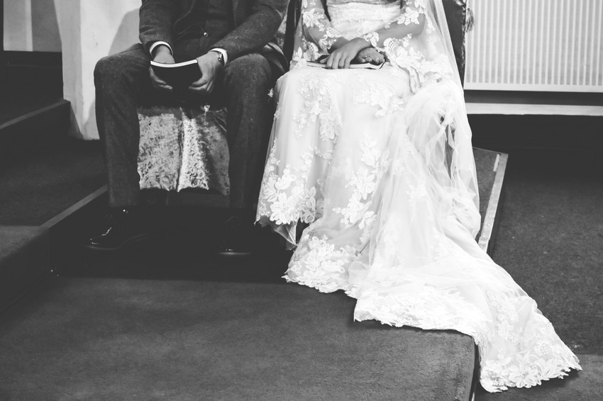 Wedding Photographer Birmingham, close up black & white image of the bride & groom during the ceremony, arty of their hands