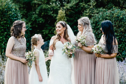 Hampton Manor Wedding Photographer Solihull, the bride & bridesmaids chatting informal natural photograph during a summer wedding