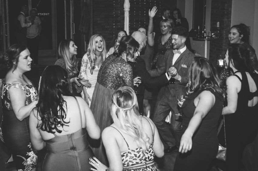 Wedding Photographer Birmingham for non traditional couples, wedding guests laughing & dancing, bride & groom dancing with guests at Wootton Park Henley in Arden
