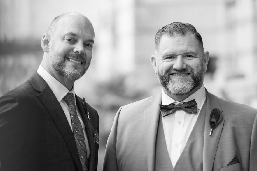 Same sex Wedding Photographer Birmingham, close up portrait of the grooms, black & white photograph
